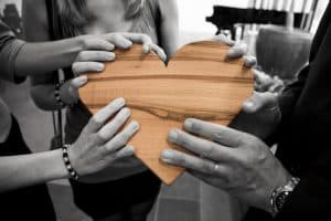 people holding a heart - love